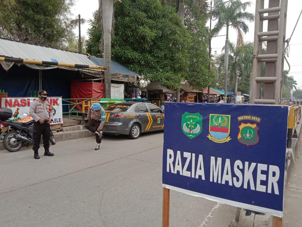 Oprasi Yustisi di depan pasar bersih pintu sebelas Jababeka, Minggu (27/09/20).