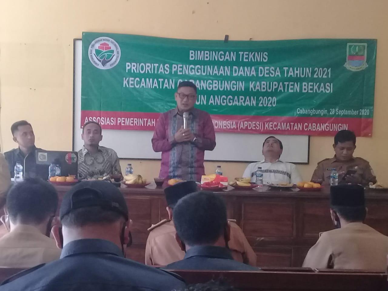 Bimbingan Teknis tentang Prioritas Penggunaan Dana Desa tahun 2021 yang di laksanakan di aula Desa Sindangjaya Kecamatan Cabangbungin Kabupaten Bekasi